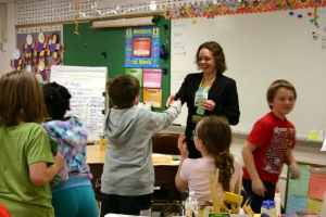 Erin Jones from the Investment Centre in DeForest with 3rd grade students at Eagle Point Elementary School
