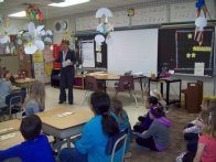 Rhonda Gilbertson from DMB Community Bank with 3rd grade students at Yahara Elementary School