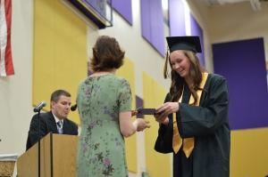 Allison Clark as she receives her diploma form principal Machelle Schwartz