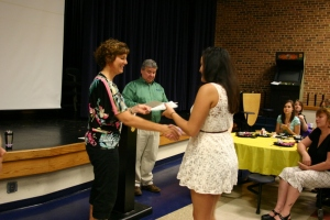 High school senior Aliah Schultz accepts her National Career Readiness Certificate from Career and Transition Counselor Judi Walsh at the Business & Marketing Internship Appreciation Breakfast on Friday, May 31.