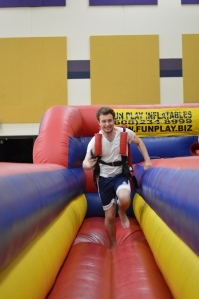 Jack Langdon running on one of the inflatable games at the 2013 Project Graduation party.