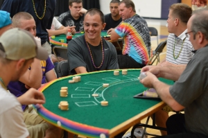 Nolan Tenpas plays a game at one of the various tables set up around the gyms at the 2013 Project Graduation party.