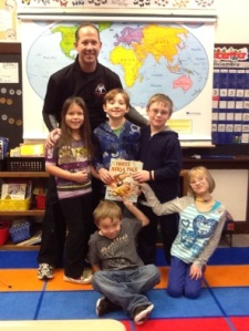On a recent visit to Julie Harrier's 1st and 2nd grade multi-age classroom, business partner Tony Armstrong of Midwest Professional Karate was treated a Reader's Theatre presentation of Three Ninja Pigs.