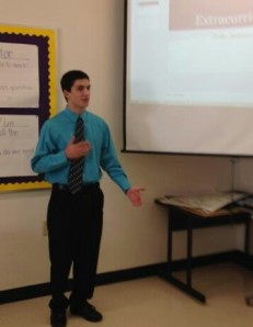 Senior Josh Marineau presents his AP Statistics project.
