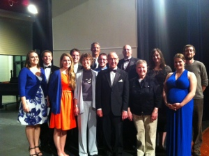 Pictured are current and former middle and high school choral and band directors, L-R:  Claire Ma, David Buehler, Sussanah Sasman, Brandon Bautz, Carol Kalscheuer, Mark Sieger, James Skaleski, Richard Fellenz, Nathan Pierce, Linda Meier, Maggie Condon, Danielle Iskandarani, and Mike Bjork.  Not pictured:  Robin Edmiston and Clare Malinowski.