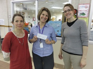 Becky Godat and Carol Barth present a check to Kathy Williams