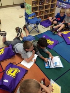 Students at YES couldn't wait to begin reading their summer books. Several chose to read their new books during a recent indoor recess.