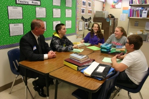 Students interview President of DMB Community Bank, Brad Schroeder.
