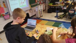 Boy working on makey makey project