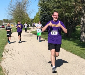 staff and students running