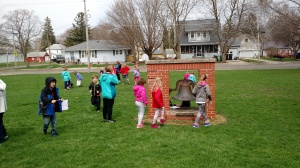 students hunting for eggs on school grounds