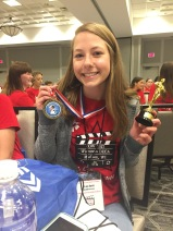 DeForest junior Rachel Anderson with her medal and trophy after winning 1st place in her Marketing Role Play.