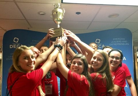 DECA members and the first place trophy