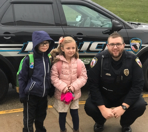 Jameson and Clara Iwanski with Officer Hughes