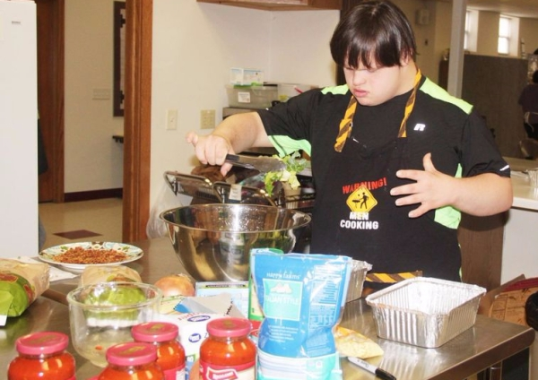 Student prepares a casserole