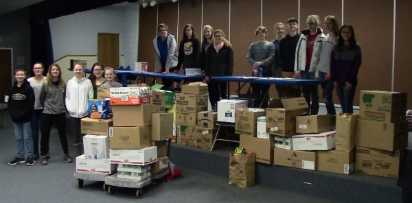Students with several boxes of food
