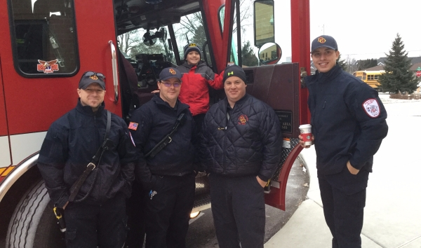 Colin and four firefighters in front of fire truck