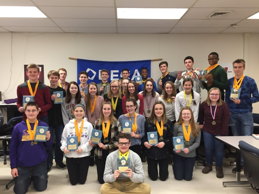 DECA students with awards