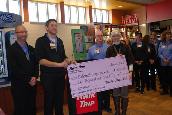 Principal Machell Schwarz accepts check from Kwik Trip