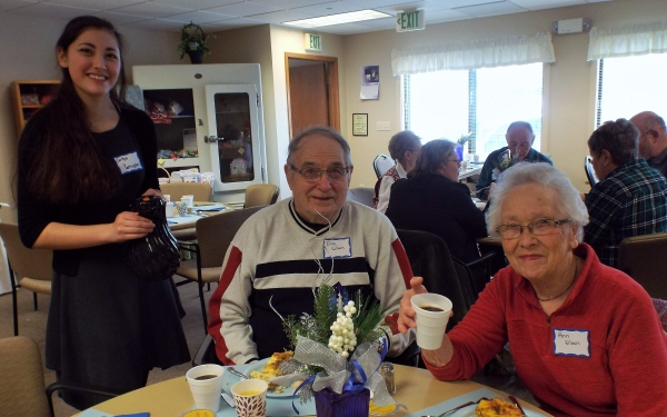 DAHS student with two other adults at breakfast