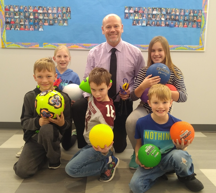 Five students who participated in Tri 4 Schools and Principal Roy Bernards