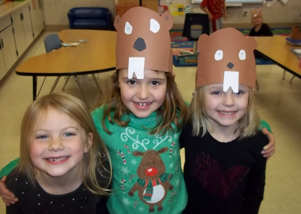 Three students with hand-made groundhog day hats