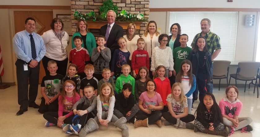 group photo of 3rd grade class with Rotarians