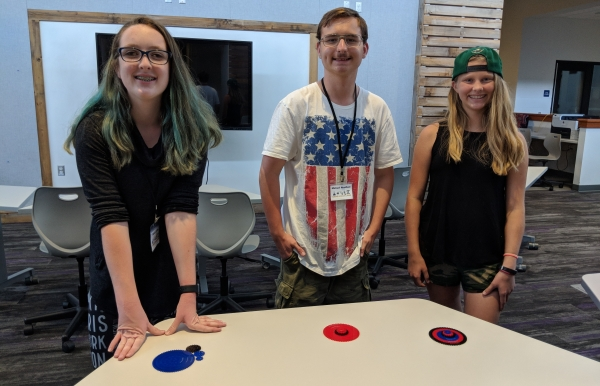 Three students with their 3-D printed objects