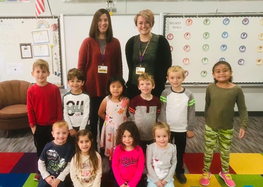 Group of kindergarten students with two JA volunteers