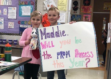 Maddie and Dawson (holding sign)