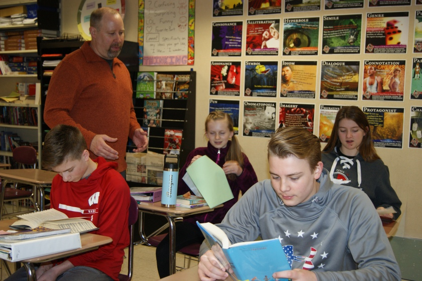 Students in desks with Greg Vandehey standing