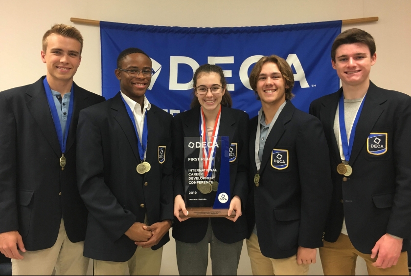 Five DECA students with awards