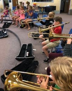 Students playing trombones