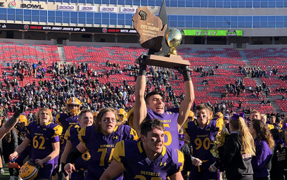 football players with trophy