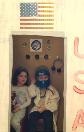students pretending to be astronauts