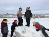 students playing in snow